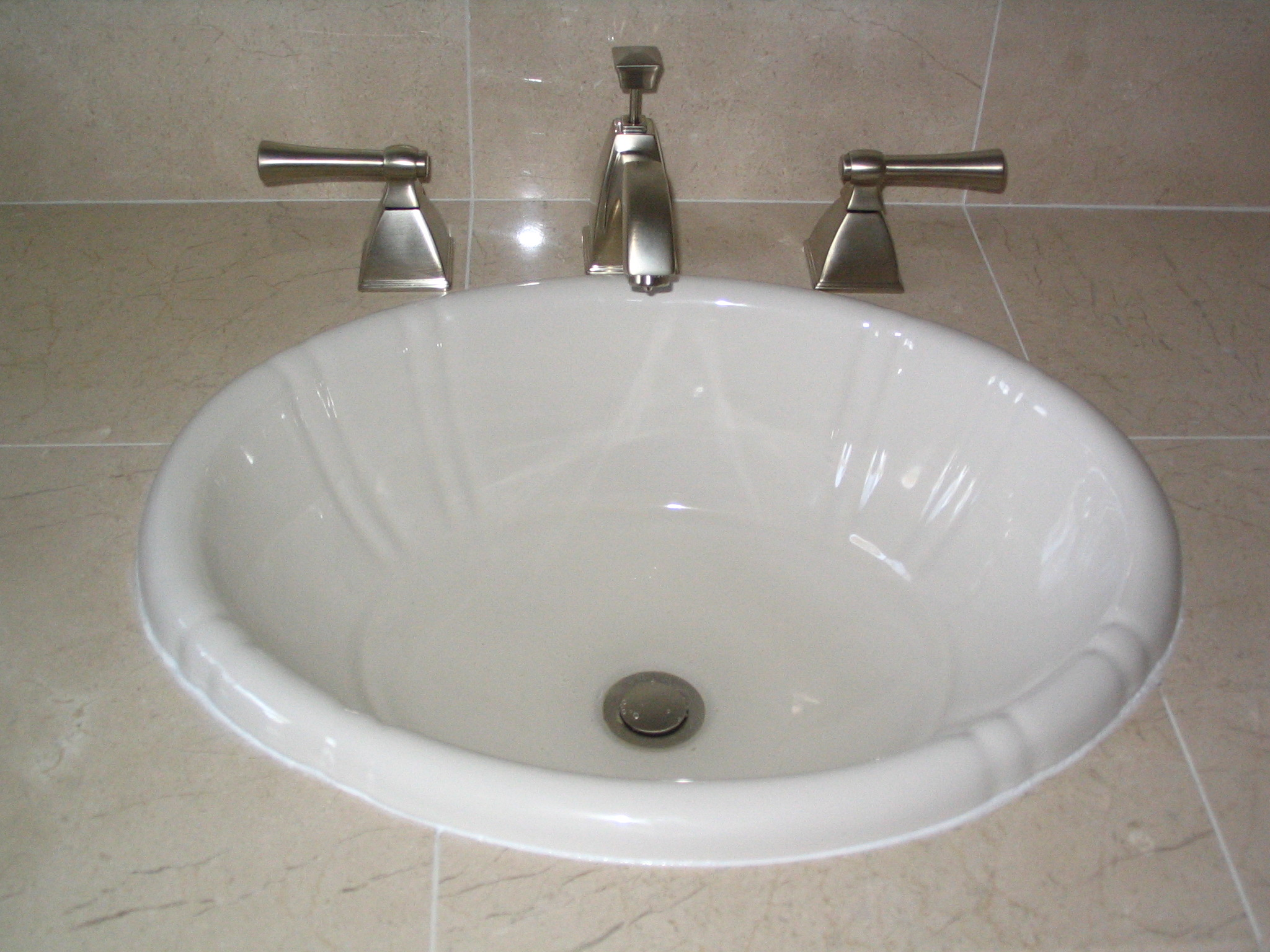 Faucet For Bathroom Sink : INSTALLING SINK FAUCETS - Faucets