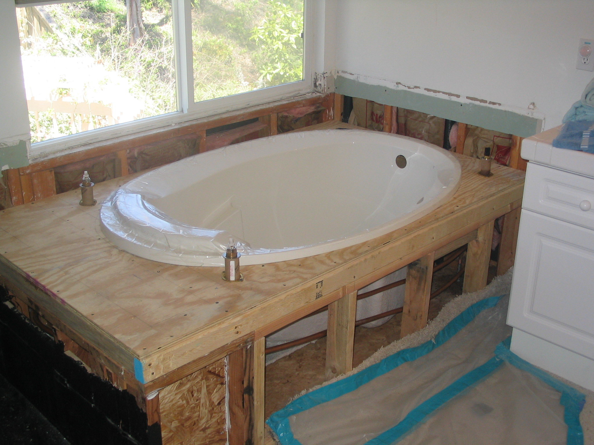 Tub shower photo gallery - Installing tile around bathtub ...